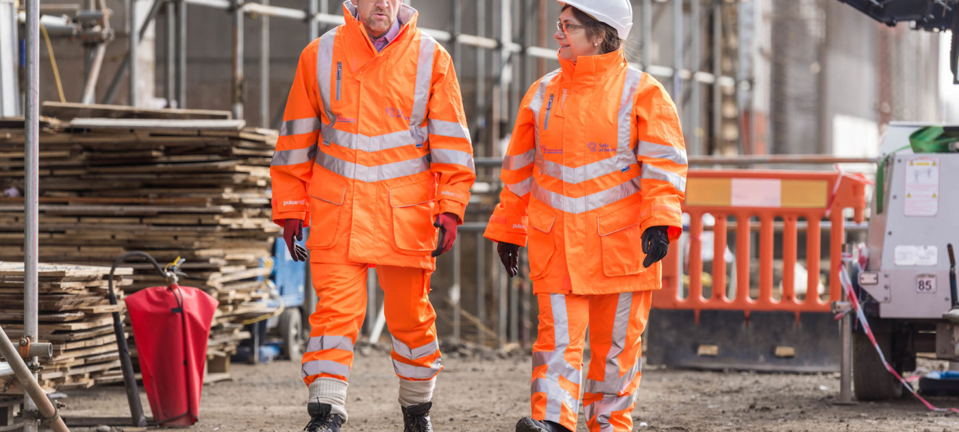 Health and safety workers in orange PPE