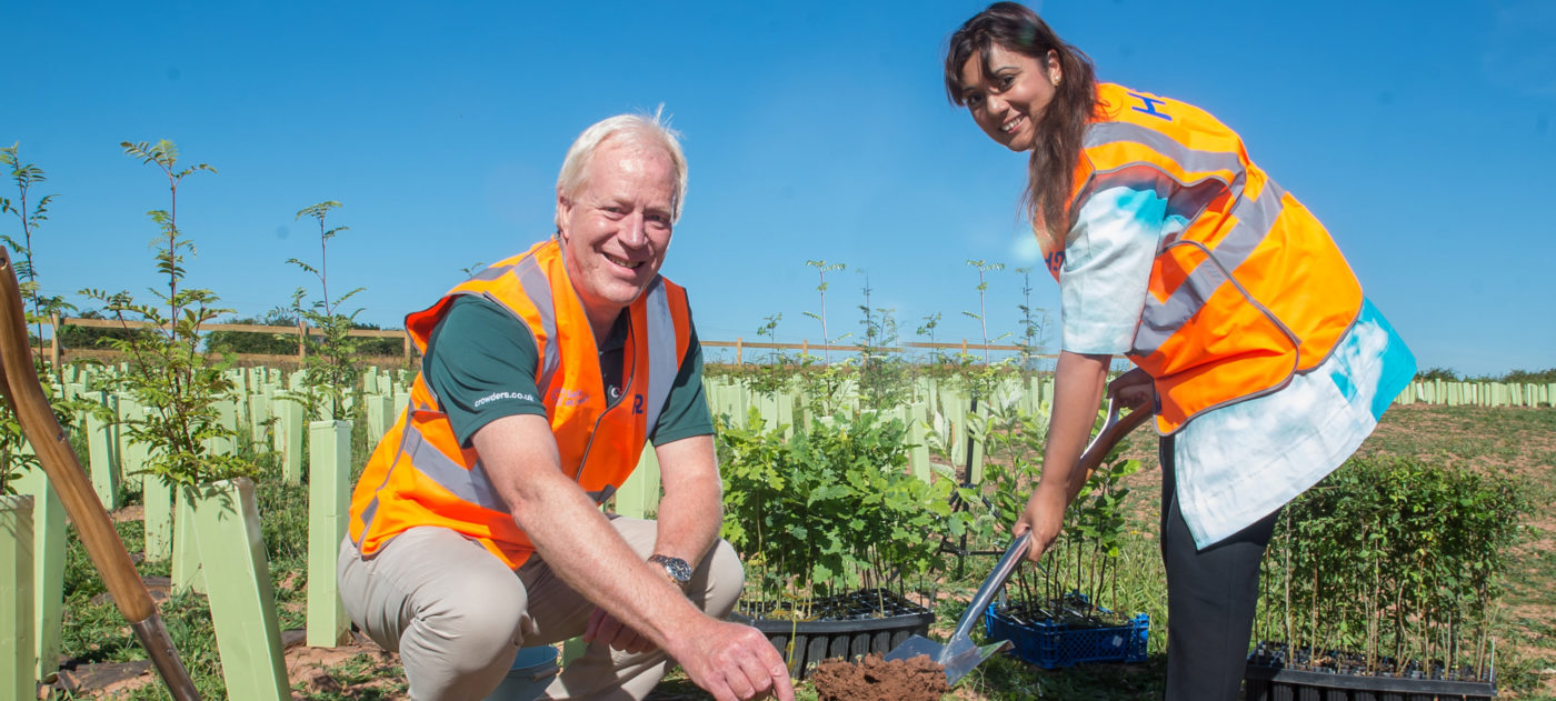 Robert Crowder and Nusrat Ghani MP plant an oak tree